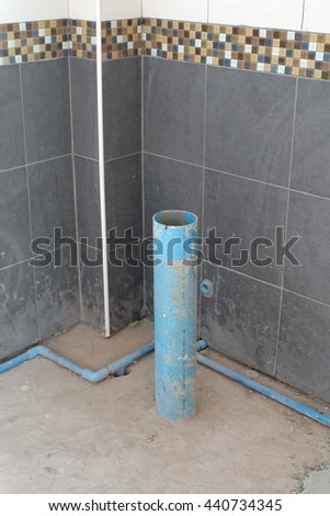 unfinished toilet detail in construction site - stock photo
