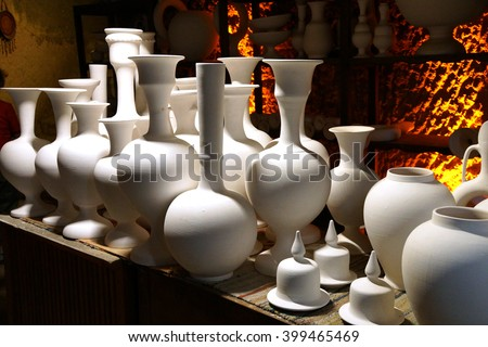 Unfired greenware vases and pots await the kiln,  pottery factory in Avanos, Turkey - stock photo