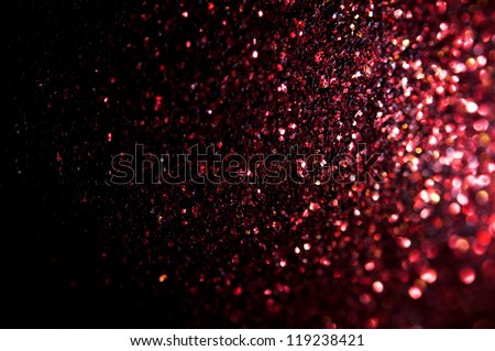 Unfocused abstract red glitter background - stock photo