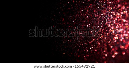 Unfocused abstract red glitter background with copy space - stock photo