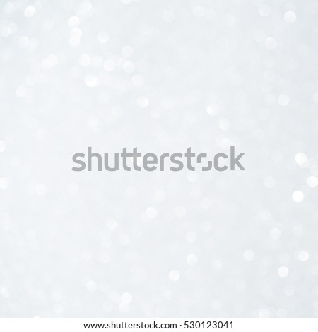 Unfocused abstract white glitter bokeh holiday background. Winter xmas holidays. Christmas