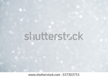 Unfocused abstract white glitter bokeh holiday background. Winter xmas theme. Christmas.  - stock photo