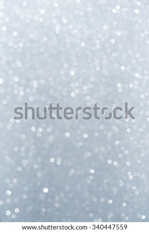 Unfocused abstract white glitter holiday background. Winter xmas theme. Christmas.