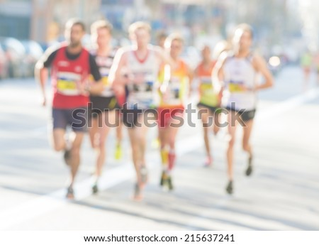 Unfocused marathon runners - stock photo