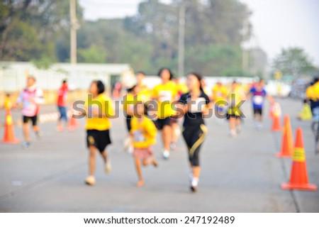Unfocused marathon runners (Blur) - stock photo