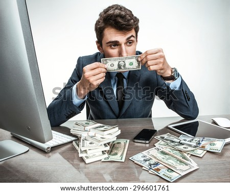 Unfortunate businessman dissatisfied with his earnings, profit, income, benefit, margin - stock photo