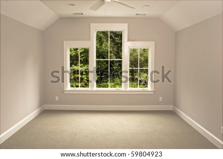 unfurnished attic bedroom with view windows - stock photo