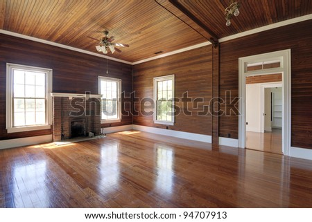 Unfurnished living room with wood paneling - stock photo