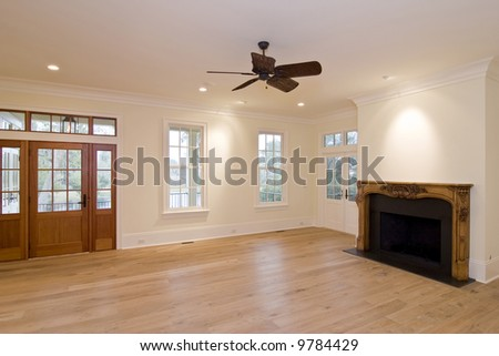 unfurnished luxury livingroom with intricately carved mantle, place your own furniture - stock photo