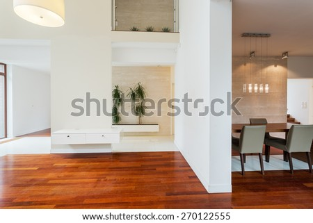 Unfurnished new lounge and separated dining hall - stock photo