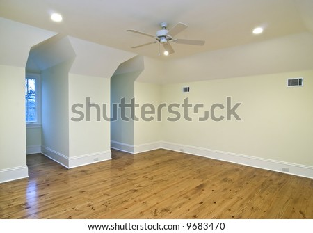 unfurnished upstairs bedroom with two gable windows, place your own furniture - stock photo