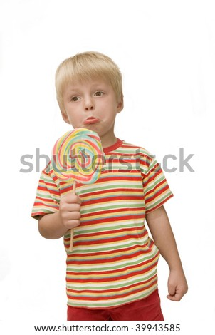 Ungrateful child holds really large lollipop - stock photo