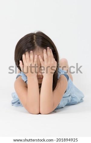 Unhappy Asian child - stock photo