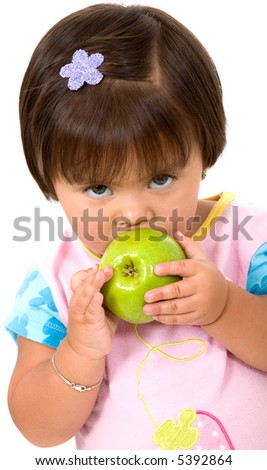 unhappy baby girl eating a green apple isolated over a white background - stock photo