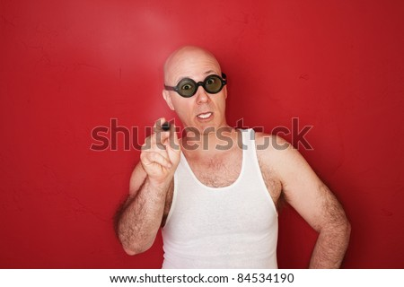 Unhappy bald Caucasian man with cigar over red background - stock photo