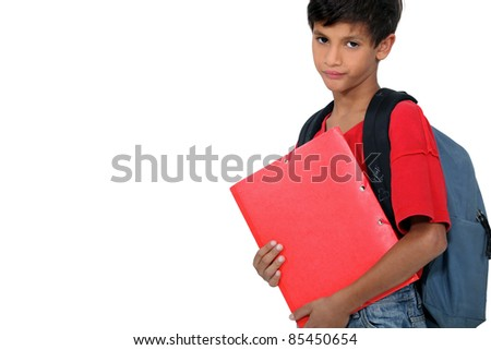 Unhappy boy on the first day of school - stock photo