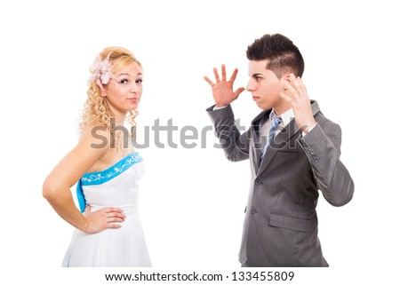 Unhappy bride and angry groom arguing, isolated on white background - stock photo