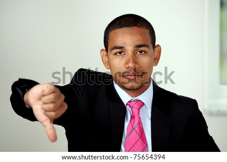 Unhappy business man thumbs down sign - stock photo