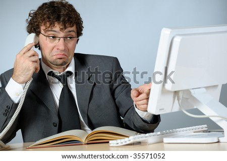 Unhappy businessman - stock photo