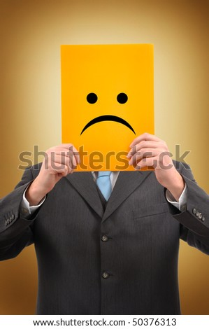 Unhappy Businessman in gray suite holding a yellow folder with sad emoticon face drawn on it