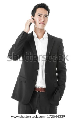 Unhappy businessman on the phone - stock photo