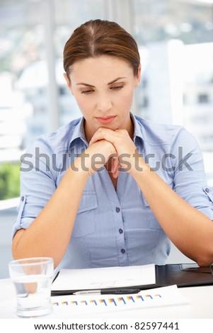 Unhappy businesswoman - stock photo