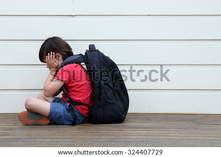 Unhappy child. - stock photo