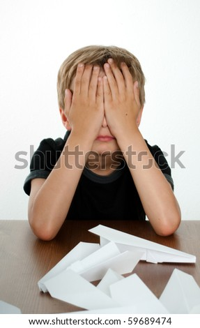 Unhappy Child Closing Face with HAnds in Frustration - stock photo