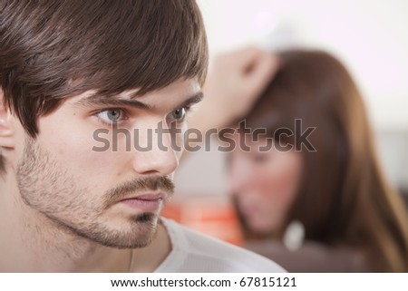 unhappy couple and conflict situation at home - stock photo