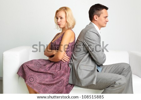 Unhappy couple going through break-up - stock photo