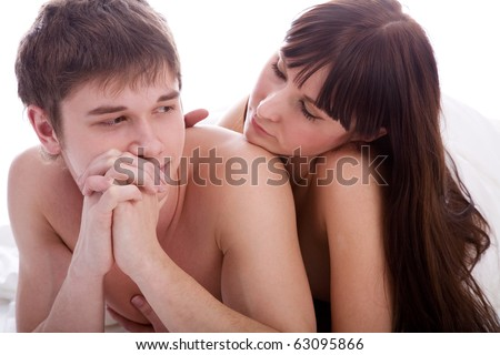 unhappy couple in bed - sexual related problems - stock photo