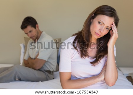 Unhappy couple not talking after an argument in bed at home - stock photo