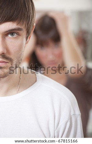unhappy couple - sad man and frustrated woman in despair - stock photo