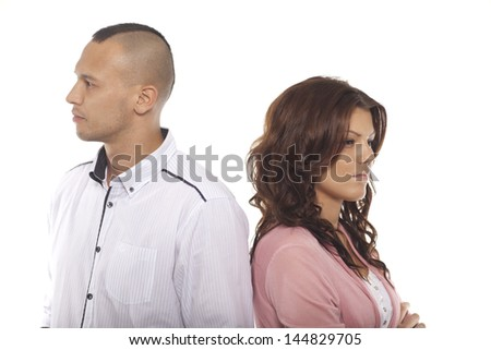 Unhappy Couple Standing Back To Back Over White Background - stock photo