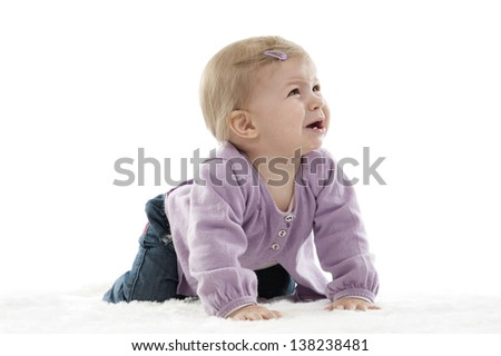 unhappy crawling baby, isolated on white background