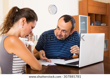 Unhappy customer complains to agent of insurance - stock photo