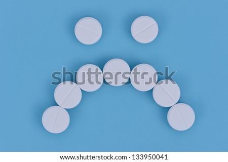 Unhappy face medicine - stock photo