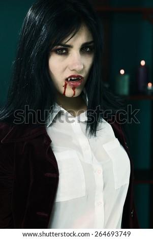 Unhappy female vampire very aggressive - stock photo