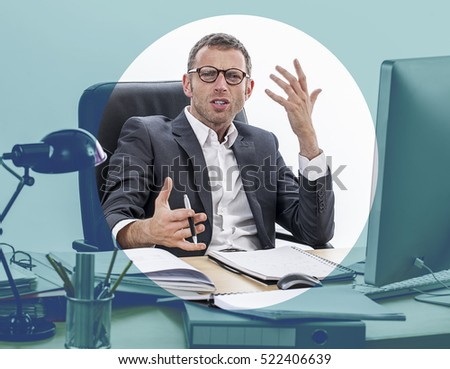 unhappy frowning middle aged businessman sitting at his desk, expressing misunderstanding, complain and anger, focusing effects