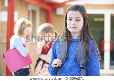 Unhappy Girl Being Gossiped About By School Friends - stock photo