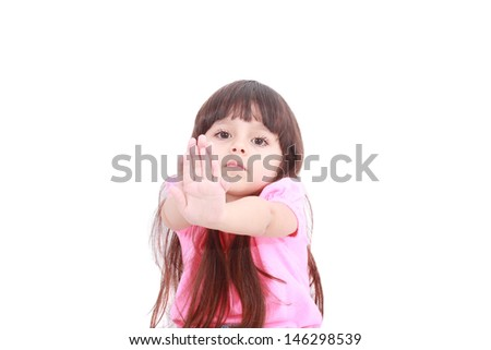 Unhappy girl saying stop with her hand - stock photo