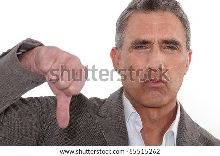 Unhappy grey-haired man - stock photo