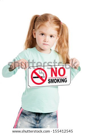 Unhappy little girl holding a no smoking sign. Isolated on white background. - stock photo
