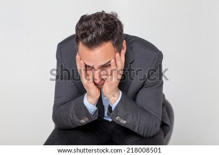 Unhappy man - stock photo