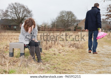man walking away from a woman unhappy man walking away woman after stock photo 96591211 4422