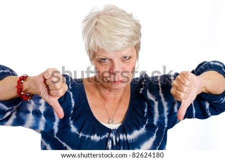 Unhappy mature white haired woman with two thumbs down. - stock photo