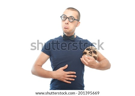 Unhappy nerd in eyeglasses and his only friend skull