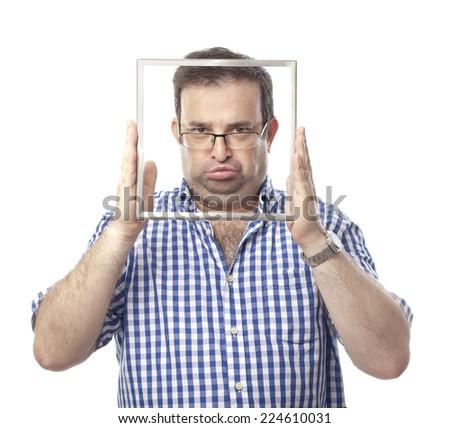 unhappy nerd man  with frame - stock photo