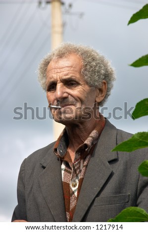 Unhappy old man - stock photo