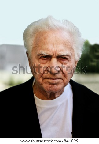 Unhappy old man frowning - stock photo